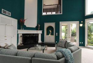 Traditional Living Room with Cathedral ceiling, Carpet, Cement fireplace, French doors, Loft, Wall sconce
