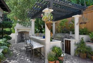 Contemporary Patio with Jabalpur barstool, exterior tile floors, Trellis, Fence, outdoor pizza oven, Outdoor kitchen