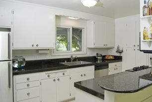 Modern Kitchen with Vinyl floors, European Cabinets, flush light, Flush, Simple Granite, Simple granite counters, U-shaped