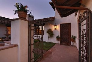 Mediterranean Front Door with Gate, Fountain, exterior concrete tile floors, Pathway, exterior tile floors, Raised beds