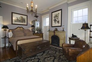 Eclectic Guest Bedroom with Carpet, stone fireplace, Laminate floors, Crown molding, Chandelier