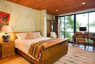 Eclectic Guest Bedroom with Standard height, terracotta tile floors, sliding glass door, can lights
