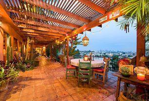 Eclectic Patio with exterior terracotta tile floors, Trellis, sliding glass door, Deck Railing, exterior tile floors
