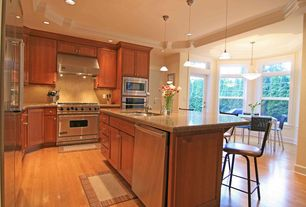 Traditional Kitchen with Simple granite counters, Flat panel cabinets, Standard height, Laminate floors, Breakfast nook