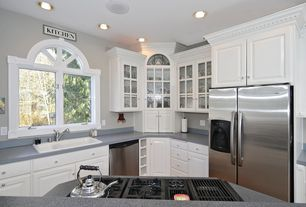 Traditional Kitchen with Raised panel, Transom window, Soapstone counters, Kitchen island, Glass panel cabinet, U-shaped