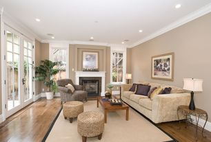 Modern Living Room with Laminate floors, brick fireplace, Casement, Standard height, French doors, Fireplace, can lights