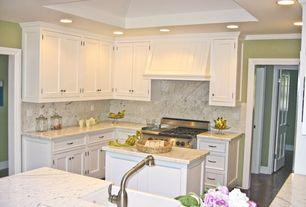 Traditional Kitchen with High ceiling, Custom hood, Complex marble counters, Crown molding, Laminate floors, L-shaped
