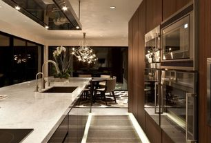 Modern Kitchen with Kitchen island, limestone floors, Carrara white marble countertop, Chandelier, Complex marble counters