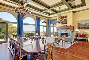 Traditional Great Room with Fireplace, Chandelier, Laminate floors, Standard height, French doors, stone fireplace