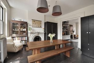 Rustic Dining Room with Cement fireplace, Pendant light, Hardwood floors