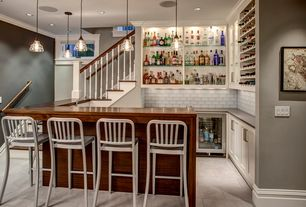 Cottage Bar with Restoration hardware lass barn pendant, Built-in bookshelf, Concrete tile , interior brick, Crown molding