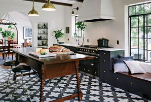 Eclectic Kitchen with Undermount sink, Corian counters, European Cabinets, vintage turned leg table, Subway Tile, Window seat