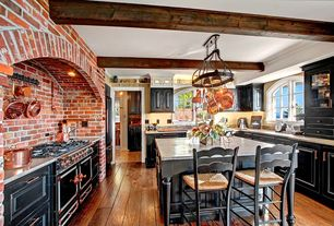 Rustic Kitchen with Simple granite counters, Flush, Arched window, Bella Beams, LeMans Counter Stool, Breakfast bar, U-shaped