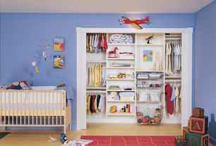 Contemporary Kids Bedroom with California Closets: Infants, Kids and Teens Organizing Solutions, Paint 1, Laminate floors