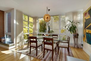 Contemporary Dining Room with Chandelier, Crown molding, Laminate floors