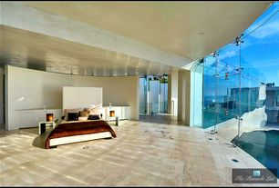 Contemporary Master Bedroom with High ceiling, sandstone tile floors, Columns