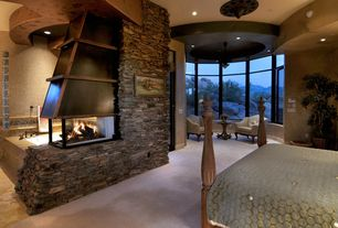 Rustic Master Bedroom with Fireplace, insert fireplace, Exposed beam, can lights, Stone wall, picture window, Paint 3, Carpet