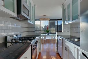 Traditional Kitchen with Glass panel, Flat panel cabinets, Galley, Dura Supreme Cabinetry Hanover Panel, Ceramic Tile, Flush