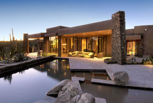 Contemporary Swimming Pool with exterior stone floors, Pathway