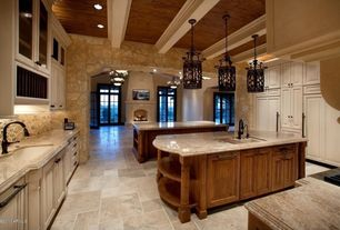 Mediterranean Kitchen with Pendant light, diano reale polished marble, Travertine counters, Undermount sink, French doors
