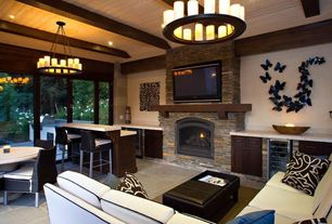 Contemporary Living Room with stone fireplace, Built-in bookshelf, Concrete tile , Chandelier, Exposed beam