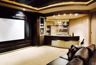 Contemporary Home Theater with Built-in bookshelf, Standard height, Carpet, can lights, Paint