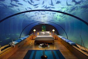 Tropical Master Bedroom with Hardwood floors, Skylight, Window seat