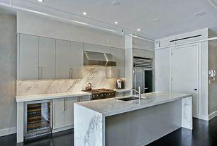 Modern Kitchen with can lights, flat door, Wall Hood, Paint, Standard height, One-wall, European Cabinets, Kitchen island