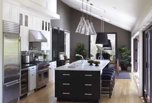 Contemporary Kitchen with Vaulted ceiling, Inset cabinets, Pot filler faucet, Pendant light, Simple marble counters, U-shaped