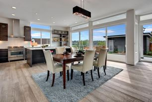Modern Great Room with French doors, can lights, Built-in bookshelf, Pendant light, picture window, Transom window, Paint
