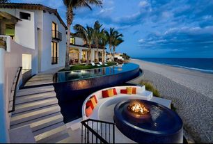Mediterranean Swimming Pool with exterior stone floors, Infinity pool, Fire pit, Waterfront, French doors