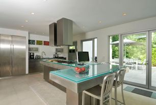 Modern Kitchen with L-shaped, Ms international jerusalem bone limestone, French doors, Breakfast bar, Glass counters