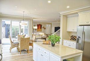 Traditional Great Room with Hardwood floors, Crown molding, Pendant light, Built-in bookshelf