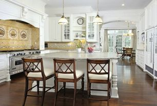 Country Kitchen with Glass panel, Custom hood, Standard height, Crown molding, Raised panel, can lights, double oven range