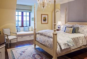 Traditional Master Bedroom with can lights, Window seat, Crown molding, Casement, Chandelier, Standard height
