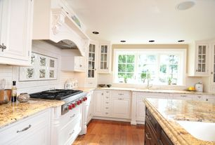 Traditional Kitchen with Kitchen island, Subway Tile, Complex granite counters, Laminate floors, Wolfe gas cooktop, L-shaped