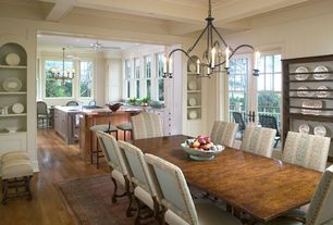 Traditional Dining Room with Chandelier, Hardwood floors, Box ceiling, Built-in bookshelf, French doors, Crown molding