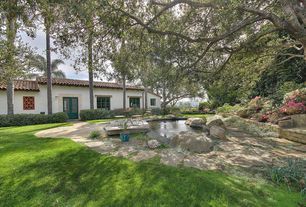 Traditional Landscape/Yard with Raised beds, exterior stone floors, Fence, Pond, Glass panel door, Pathway