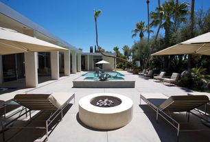 Modern Swimming Pool with exterior concrete tile floors, exterior tile floors, picture window, Fire pit, French doors