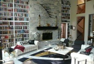 Eclectic Living Room with Built-in bookshelf, simple granite floors, High ceiling