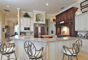 Traditional Kitchen with can lights, Custom hood, Crown molding, Ceramic Tile, Framed Partial Panel, Breakfast bar, L-shaped