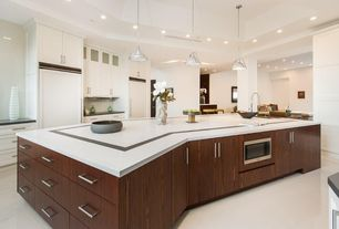 Contemporary Kitchen with built-in microwave, stone tile floors, One-wall, Slate counters, Columns, Kitchen island, Flush