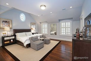 Traditional Master Bedroom with can lights, specialty window, Casement, flush light, Hardwood floors, Standard height