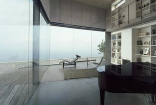Contemporary Living Room with Built-in bookshelf, High ceiling, sliding glass door, picture window, Concrete floors