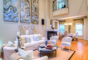Traditional Living Room with Hardwood floors, Fireplace, metal fireplace, Balcony, Ceiling fan, High ceiling
