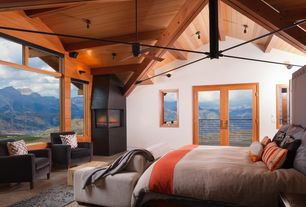 Contemporary Master Bedroom with High ceiling, Ceiling fan, Walton Loveseat in Flax, Concrete floors, Exposed beam