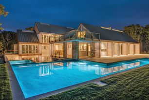Modern Exterior of Home with exterior stone floors, Pool with hot tub