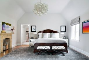 Contemporary Master Bedroom with Chandelier, specialty window, Fireplace, Hardwood floors, other fireplace, Standard height
