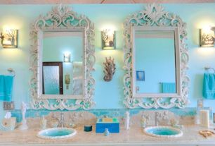 Tropical Master Bathroom with Wall sconce, Stone Tile, Howard elliott ornate turner wall mirror, Crown molding, Flush