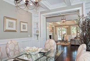 Traditional Dining Room with Exposed beam, Laminate floors, Built-in bookshelf, Wainscotting, Chandelier